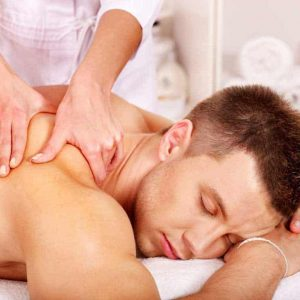 holistic massage voucher Man getting massage in spa.