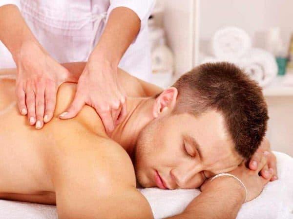 holistic massage voucher Man getting massage in spa.